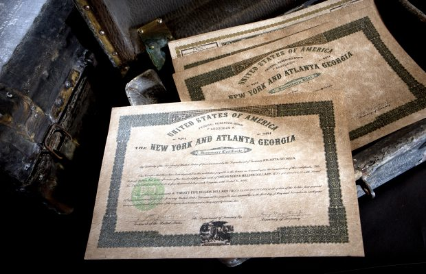 Bogus U.S. government bearer bonds, allegedly found in a Filipino jungle, are displayed in a leather case in New York, U.S., on Thursday, Dec. 8, 2011. The bonds, bearing the signature of former U.S. Treasury Secretary Henry Morgenthau Jr. and totaling $50 billion, aren't the first cache of fake bonds to have emerged from the Philippines. Photographer: Scott Eells/Bloomberg